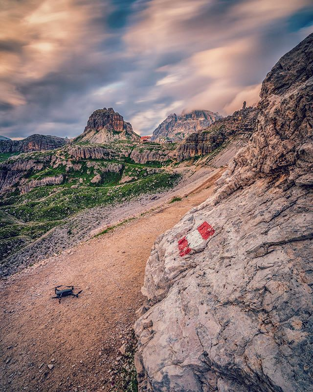 """The red and white marks on the ⛰mountain trails are really welcomed by hikers, but Drony doesn't care! And if he gets lost, RTH will (hopefully) save the day 😄 ⠀ Do you rely on Return-To-Home on your drone or prefer the manual """"come back home Lessie""""? ⠀ Ⓢ 60 sec, Ⓐ f/16, ⒾⓈⓄ 100, Ⓕ 15mm ▸ CAMERA: @sonyalpha A7Riii ▸ LENS: @venuslaowa 15mm f/2.0 ▸ FILTER: @haidafilter 10 stops ND filter ▸ POST-PRO: @skylum_global Luminar .⠀ .⠀ .⠀ #skylum #dolomites #dolomiti #dolomitiunesco #sony #sonya7riii  #naturephoto #italian_landscapes #watchthisinstagood #italia #landscape_captures #awesomeearth #ourplanetdaily #instanaturelover #nature_prefection #welivetoexplore #EarthVisuals #italy_vacations #italy_photolovers #unlimiteditaly #unlimiteditalia"""