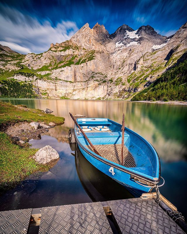 A rare rear wheeled boat in its habitat😄  The Oeschinensee is one of the many beauties of the Swiss Alps 🏔. This lake is quite small, but it's truly a picturesque one!  It's water are so blue that you really want to jump in! But I can tell that it is freezing cold also in summer! 🥶Boating around is not a bad alternative😆 ⠀ Ⓢ 60 sec, Ⓐ f/16, ⒾⓈⓄ 50, Ⓕ 15mm ▸ CAMERA: @sonyalpha #a7riii ▸ LENS: @venuslaowa 15mm f/2.0 ▸ FILTER: @haidafilter 10 stops ND filter with 15 kit ▸ POST-PRO: #madewithluminar @skylum_global ⠀ ⠀ ⠀ ⠀ ⠀ ⠀ ⠀ ⠀ #ZHIIM #switzerlandphotos #theswitzerlandguide #unlimitedswitzerland #hellozurich #swissinfluencer #swissblog #topswitzerlandphoto #swissblogger #igersswitzerland  #ig_switzerland #inLOVEwithSWITZERLAND #schweiz  #Zurich #zurichblog #visitswitzerland #discover_earthpix #earthfocus #swiss #wilderness #naturephotos #landscapehunters #sunsethunters #switzerland_vacations #longexposure_photos #venuslaowa15mm #sonyalpha7riii #oeschinensee