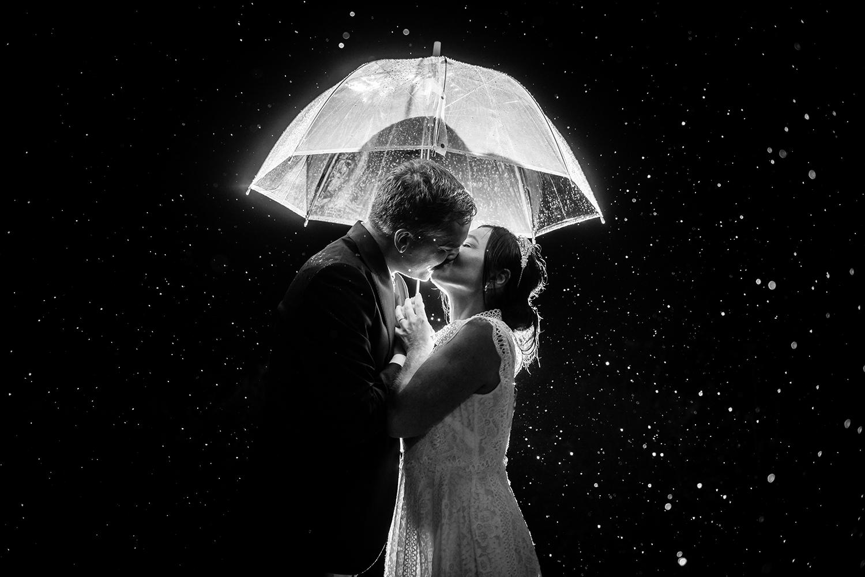 jma-photography-wedding-couple-backlit-kissing-rain.jpg