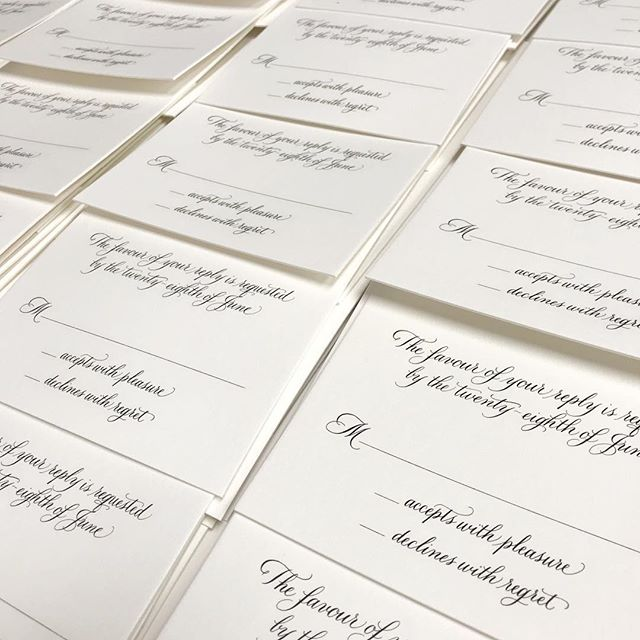 Stacks of engraved reply cards for @paperdaisiesstationery
