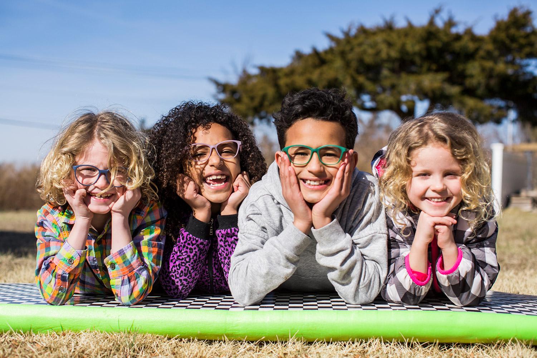 4 kids wearing Fitz Frames glasses and having fun