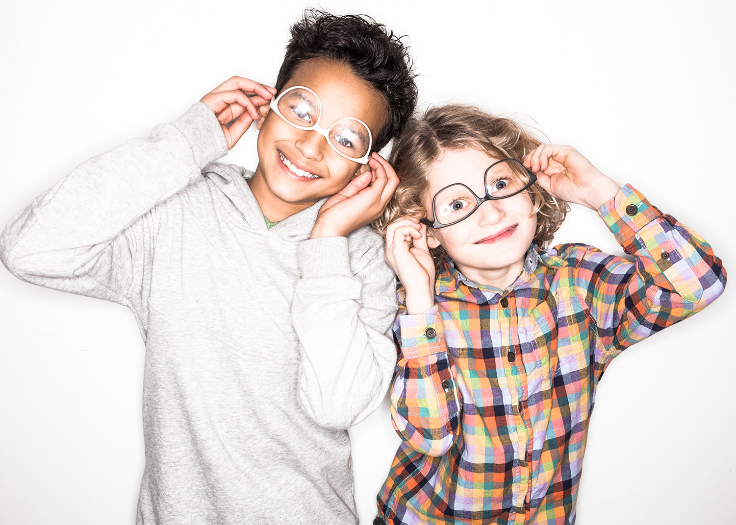 A boy and a girl wearing their 3d Printed glasses upside down