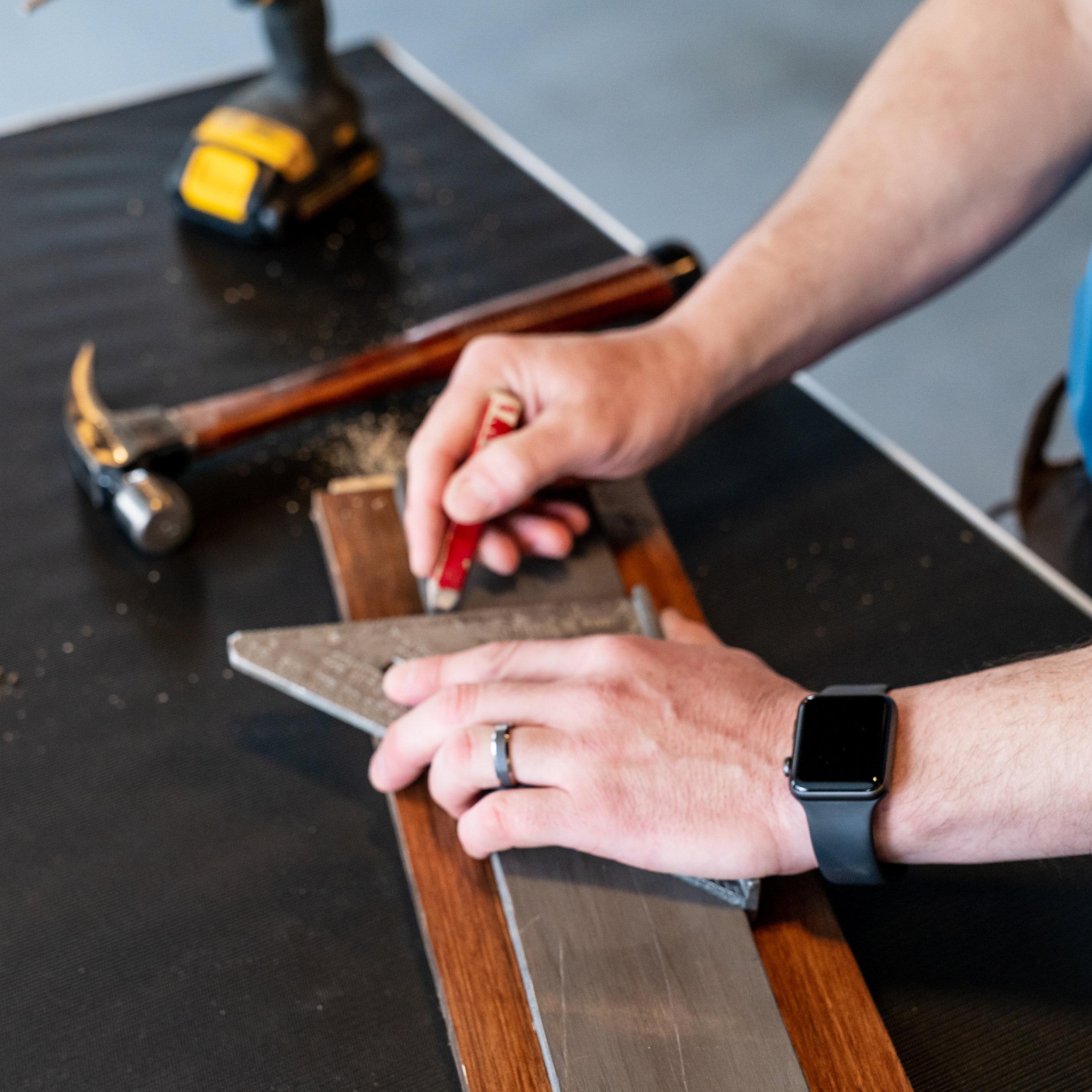Detailed carpenter in Pilesgrove, NJ | Closeup of Gary's hands carefully measuring.