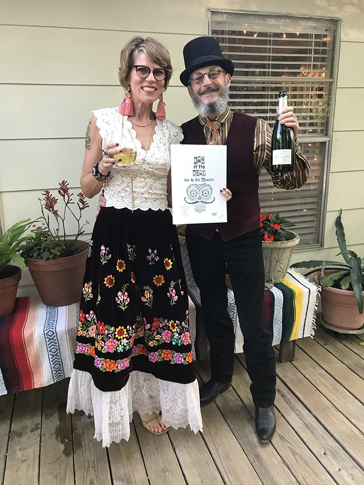 May 4, 2019—The happy couple, still single but for a few more minutes, holding the champaign and piece of original art that my good friend and partner, Wayno, gifted us.