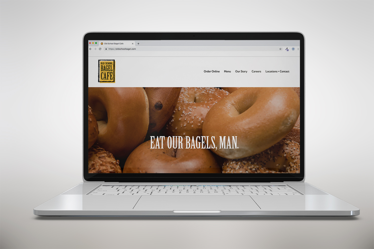Old School Bagel Cafe website on laptop screen