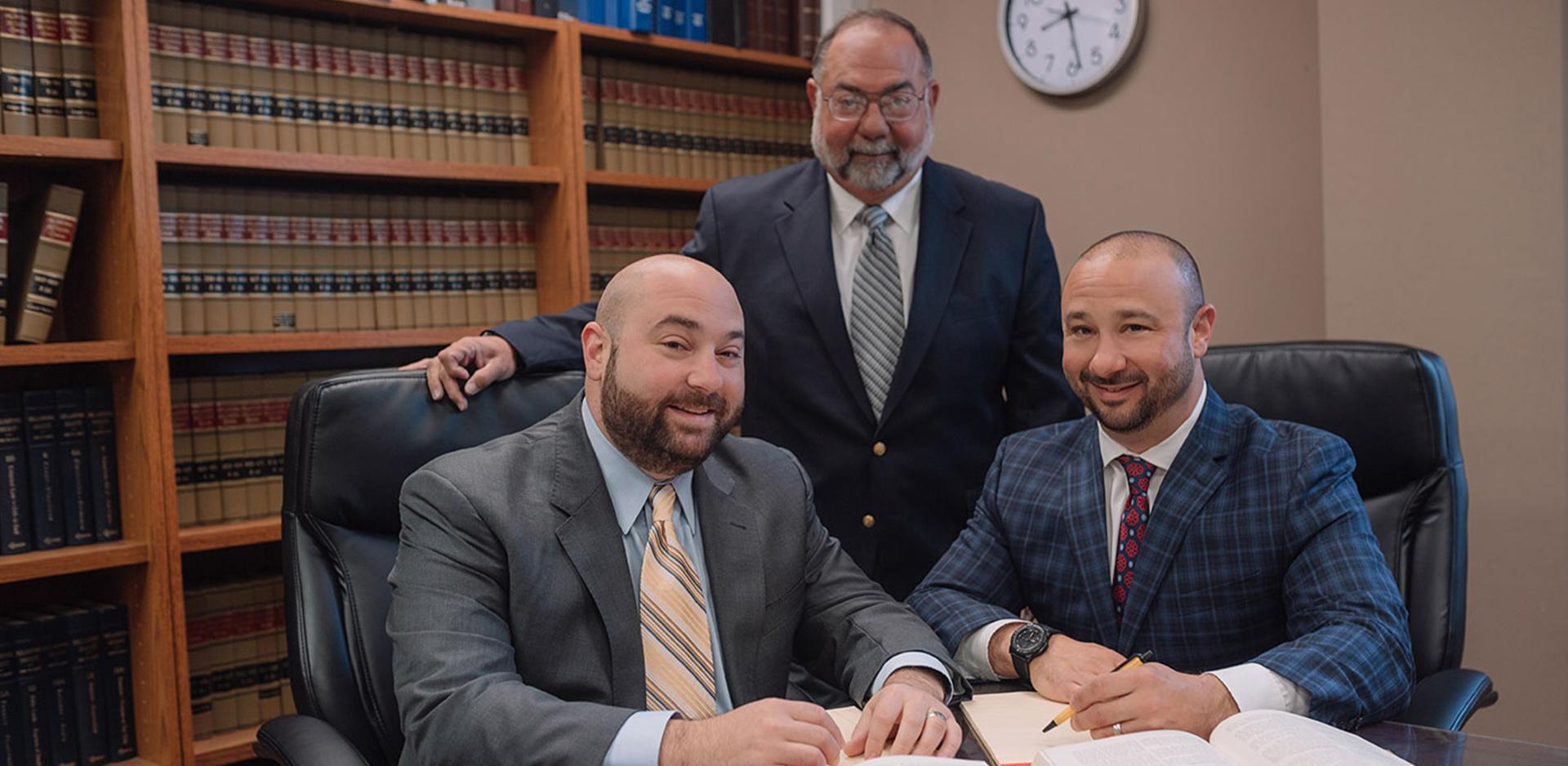Foshee & Yaffe attorneys at law sitting at desk