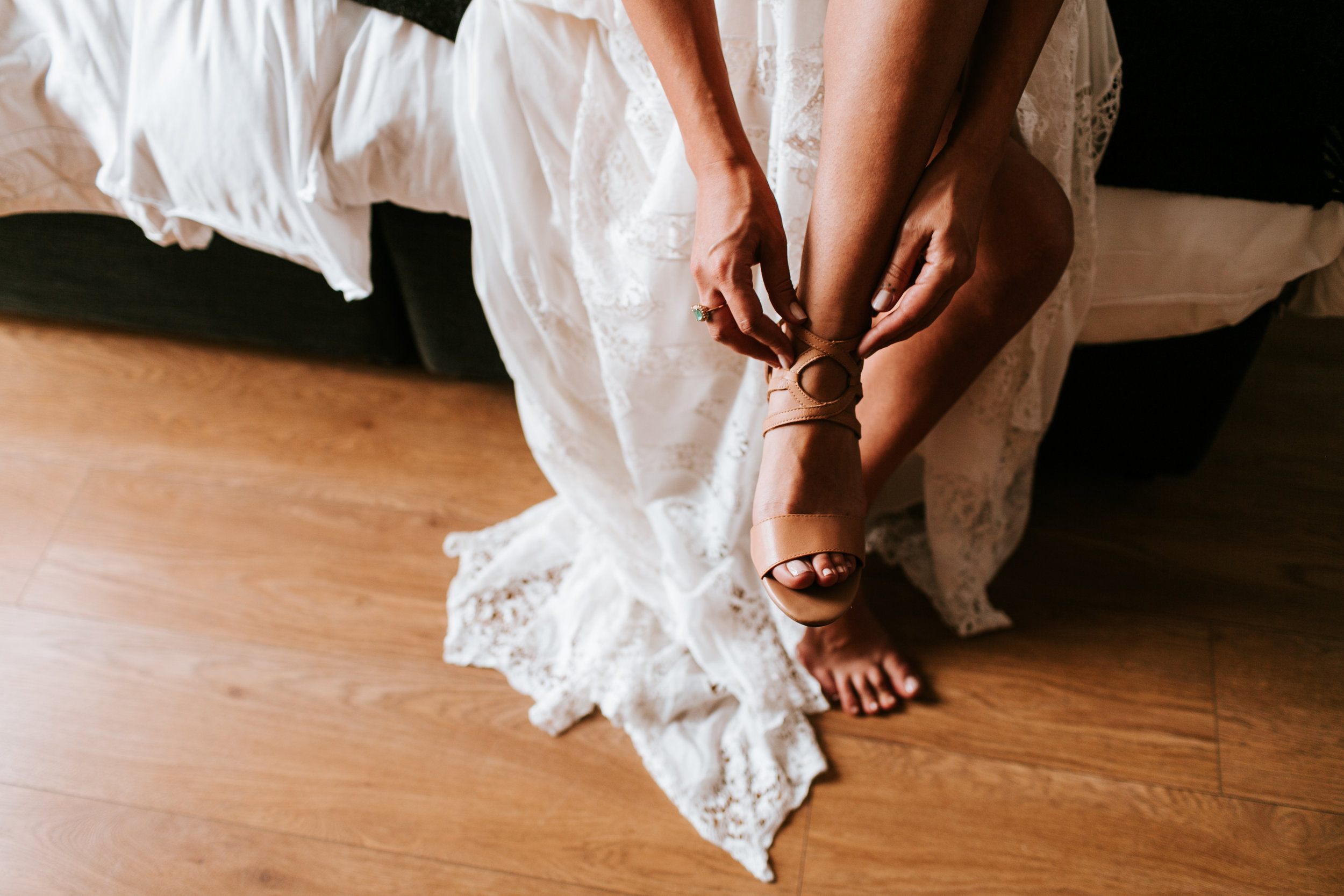 A Pair Of Shoes - Most bridal gowns come in a length that will need some alteration. It's best to bring a pair of shoes along with a small heal (if you plan to wear heals that is). These don't have to be the shoes you plan to wear on your wedding day, but something that will help you feel like you're getting the full look of the gowns you'll be trying on.