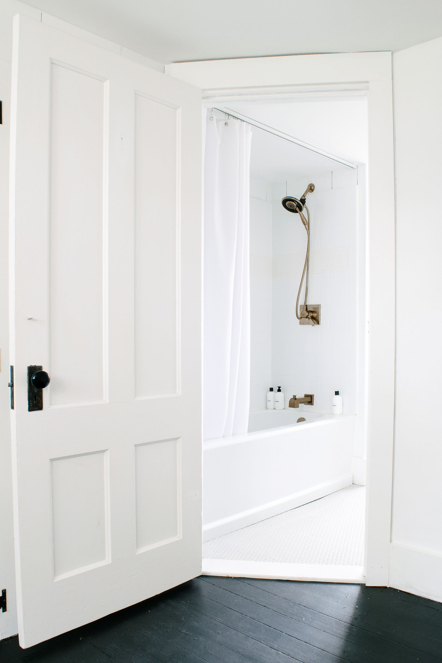 Bright historic bathroom remodel using Delta Upstile Surround, Champagne Brass Faucet and Penny Tile designed by DIY & Home Bloggers This Giant Life.