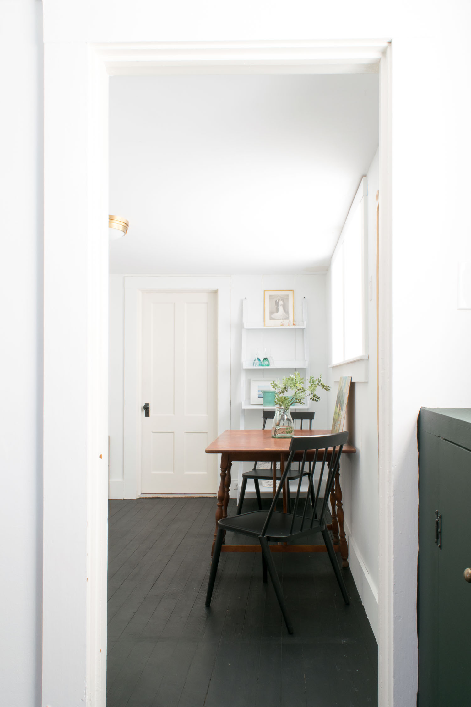 Historic home Airbnb remodel with breakfast bar and black painted hardwood floors designed by DIY & Home Bloggers This Giant Life.