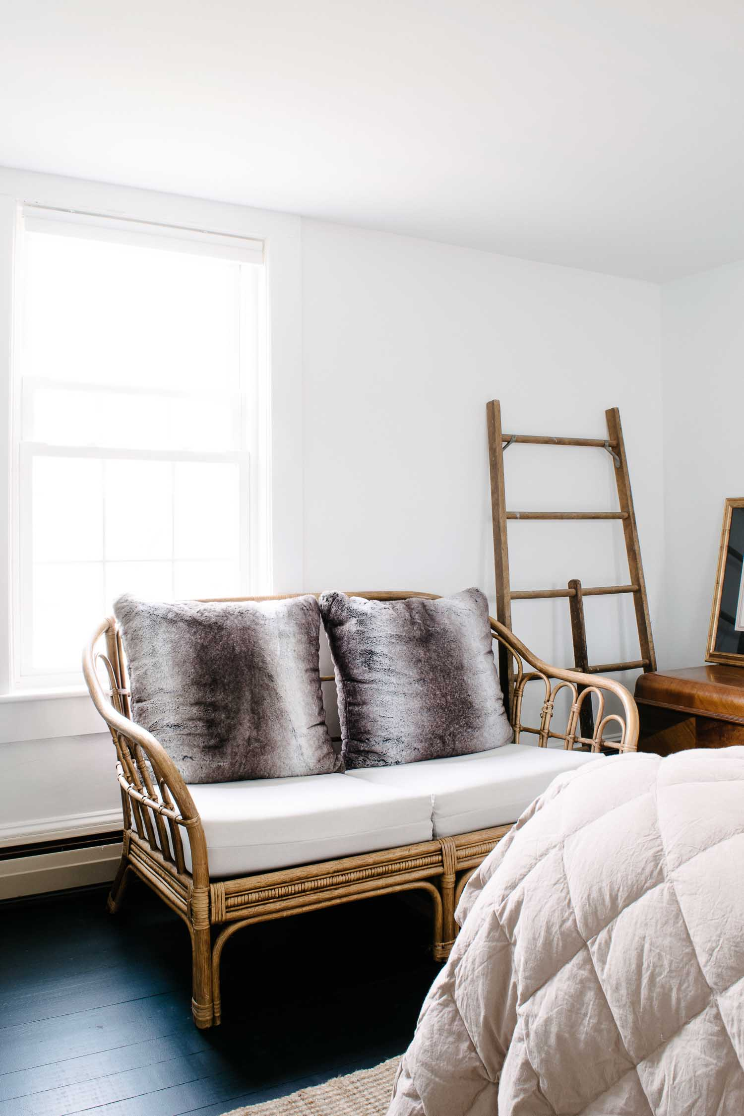 Black painted floors with a eclectic vintage style in a historic home. Designed by DIY & Home Bloggers This Giant Life. Love to do this with my vintage rattan love seat!