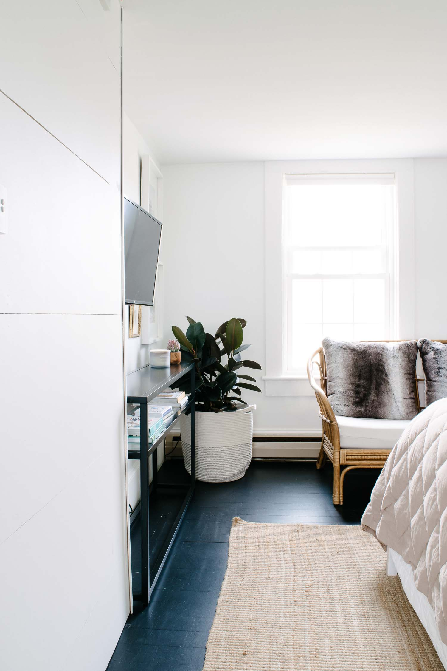 Black painted floors with bright white wall in a historic home. Designed by DIY & Home Bloggers This Giant Life.