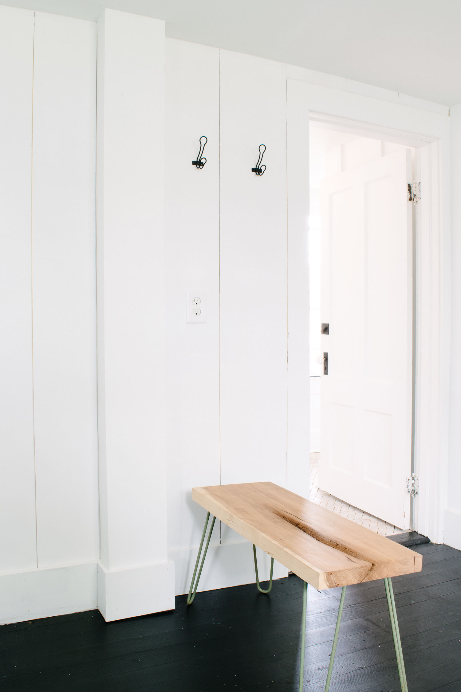 Small entryway for a short term rental or Airbnb  designed by DIY & Home Bloggers This Giant Life.