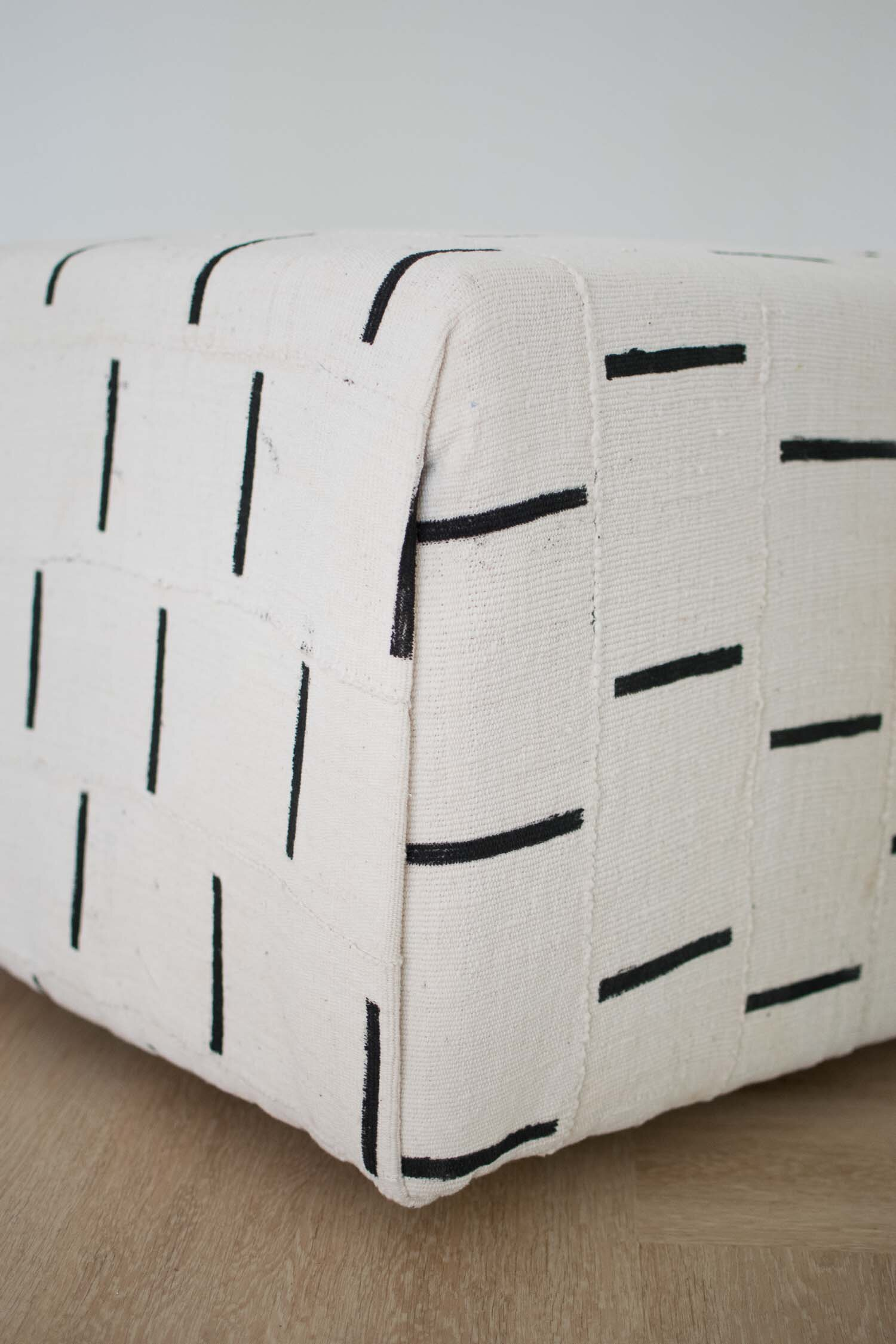 Envelope Fabric Corners on the  Boho Mud Cloth Ottoman   Designed by This Giant Life