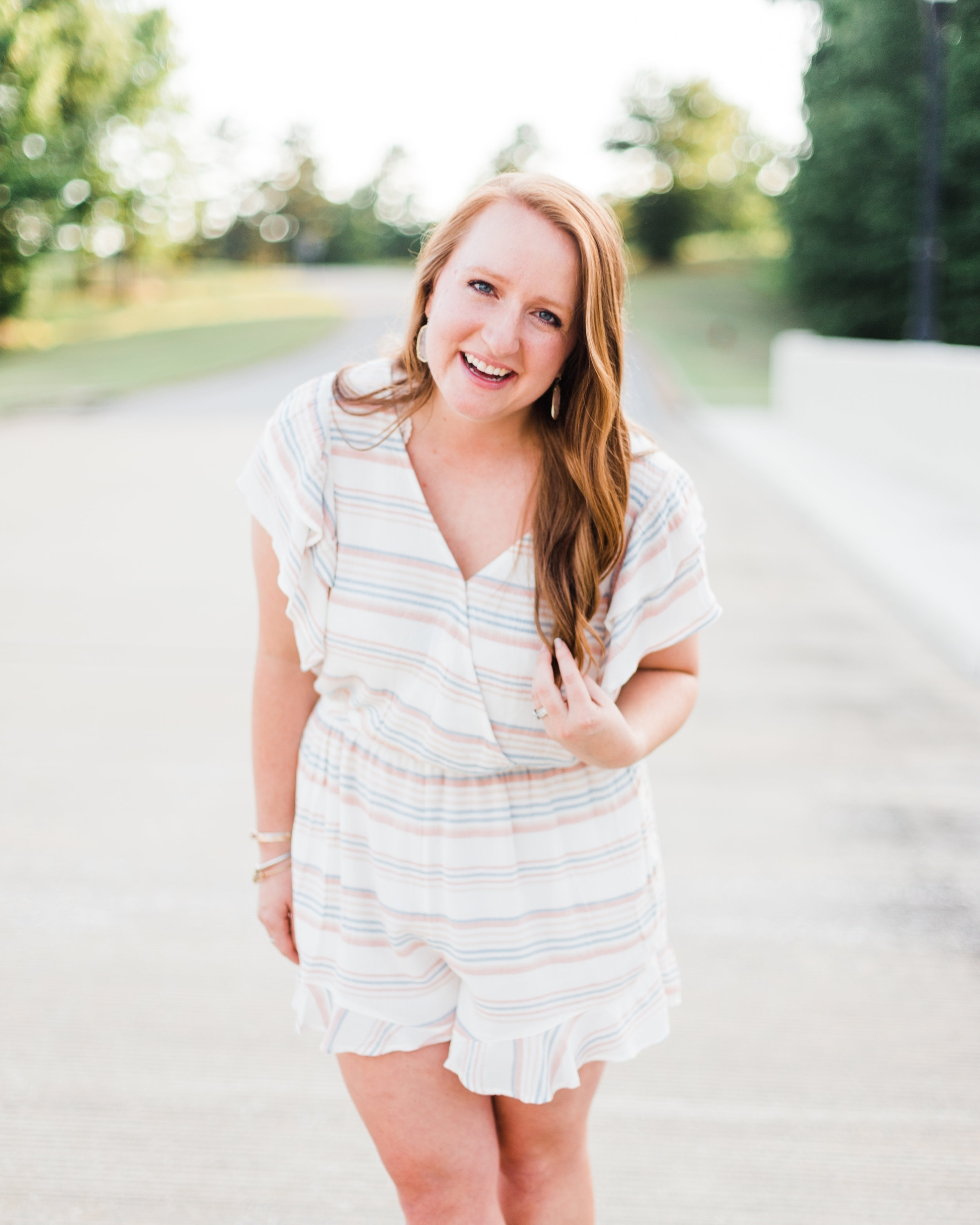 Behind the Lens - Hey there! I'm Nikki and I'm the fiery redhead behind the lens at Blue and Blue Photography. Click below to learn more about me and this business I love!