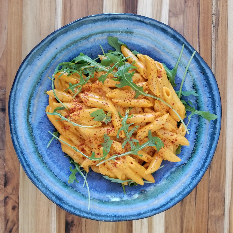 Red Pepper Alfredo Penne Pasta served with arugula ( vegan)