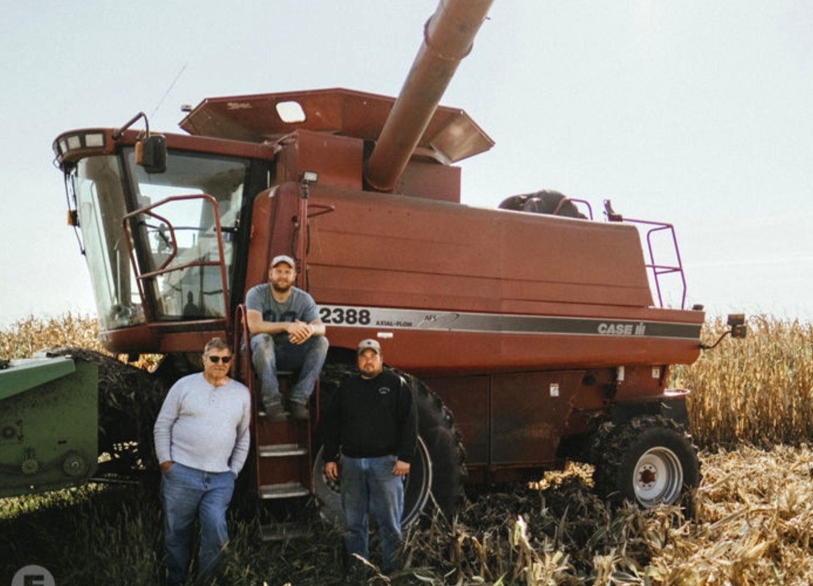 Harold Wilken, his son Ross, and his nephew Tim Vaske take a short break from the 2018 corn harvest. Photo by Judd Demaline/Feast Magazine.