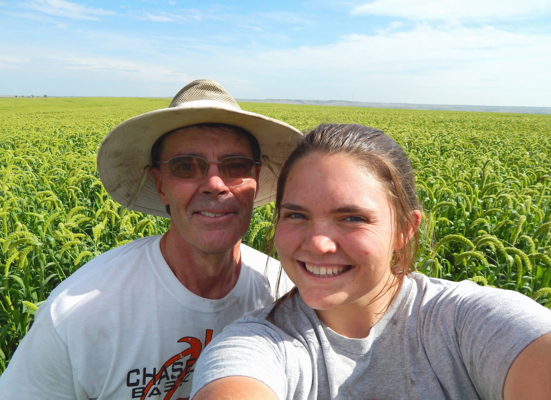 Tom Luhrs and daughter Molly in a field of White Wonder Foxtail Millet.