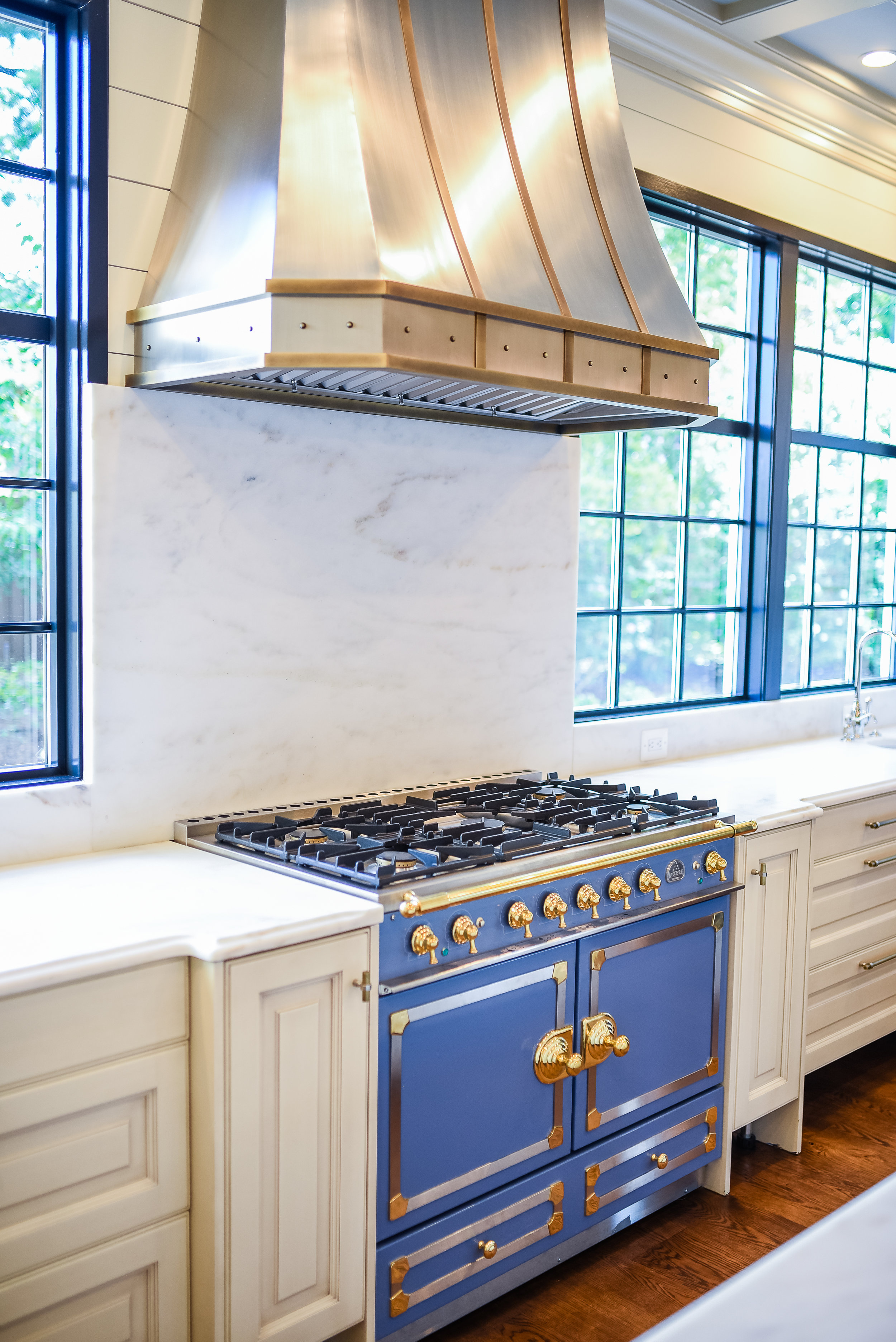 "Striking 43"" LaCornue French® range in Provence blue finish with brass knobs"