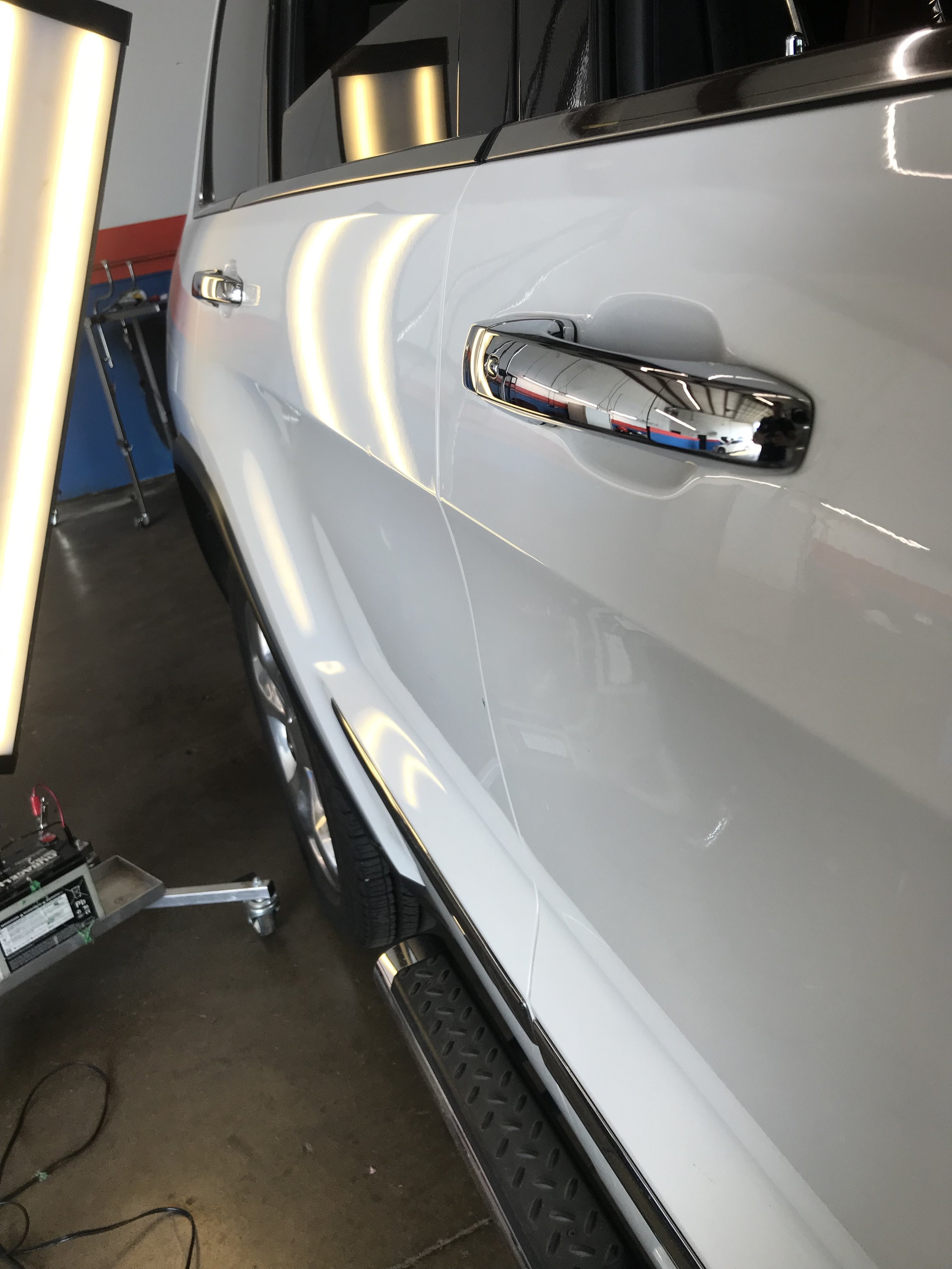 Pride in this ride restored! This beautiful Range Rover door was worked out by our PDR pros