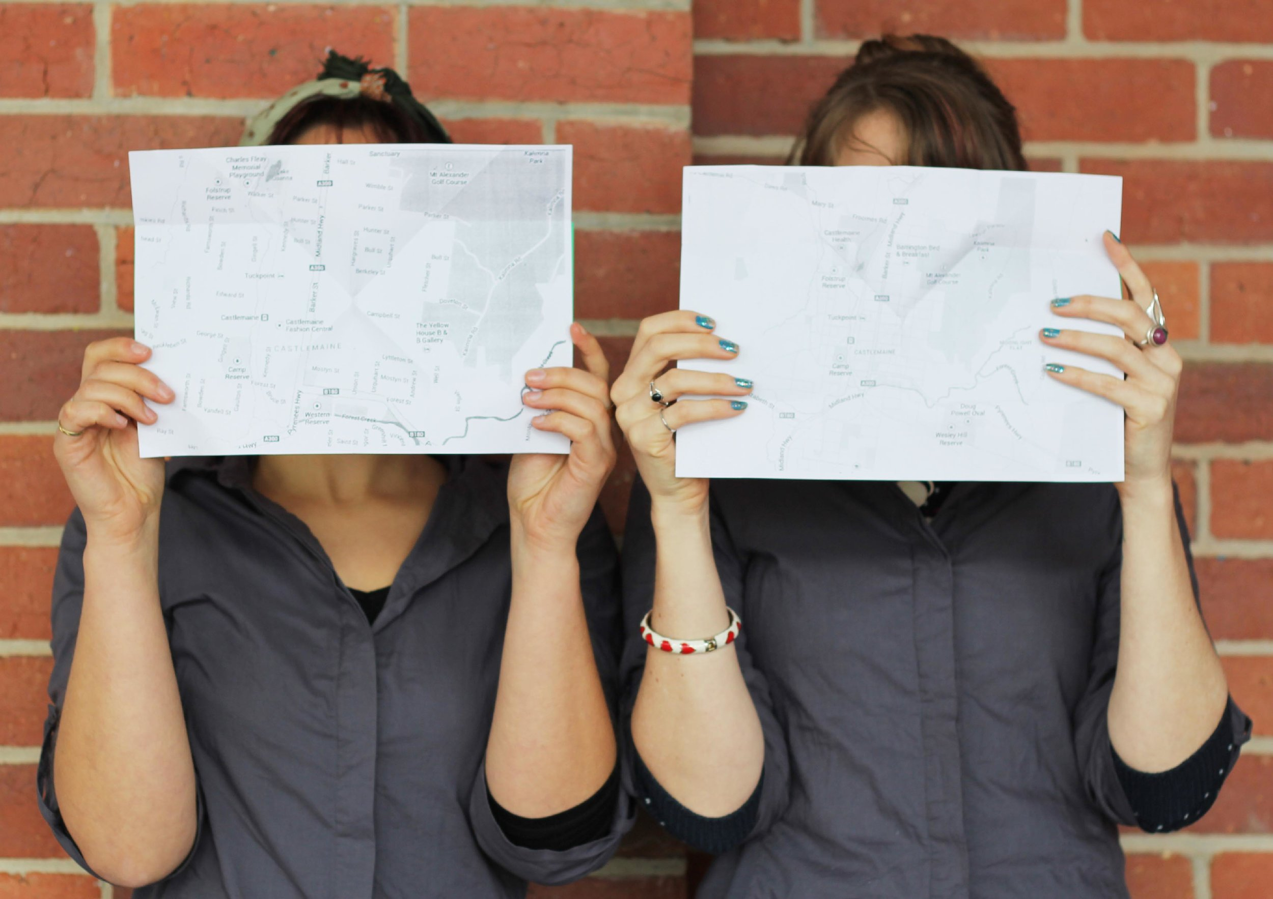 maps in front of faces bricks.jpg