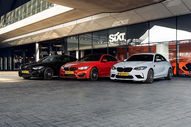 A lot of Competition at @sixtnl. Saphirschwarz, Sakhor Orange II or Hockenheim Silver? M4 Competition or M2 Competition? For @sixtnl at Amsterdam Central Station. @apa.photo @bmw @bmwm @bmwnederland @bmwmclubnederland #bmwm #bmw #bmwm4 #bmwm2 #bmwm4competition #bmwm2competition #sixt #rentacar #sixtnl #bmwmsport #motorsport #cars #bmwlife #bmw4series #bmw2series #mcompetition #m2 #m4 #carphotography #bmwforlife