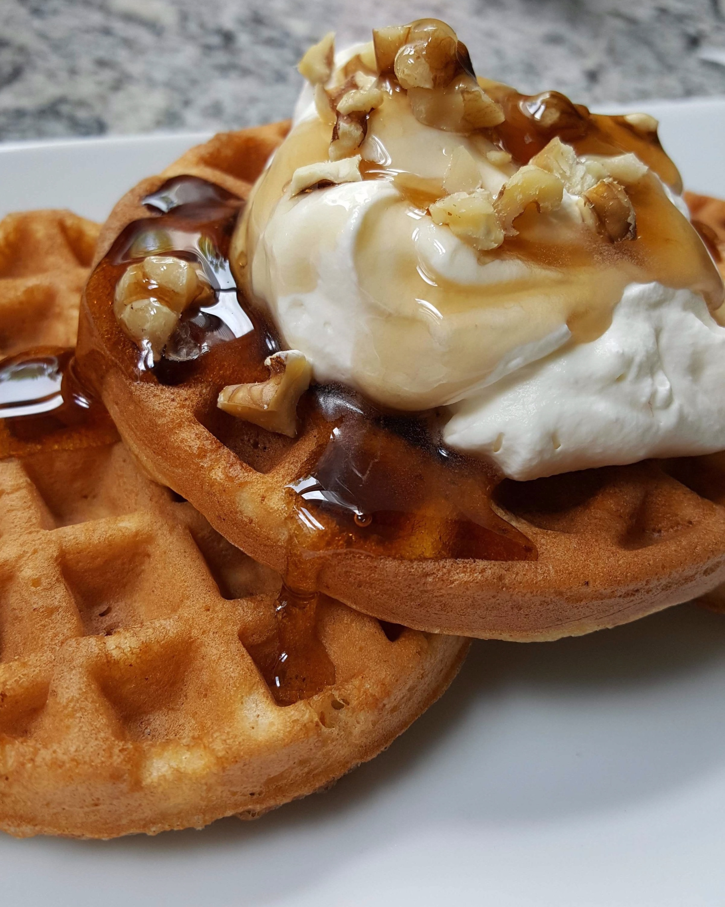 keto waffles smothered in Choc Zero maple syrup and sweetened whipped heavy cream.