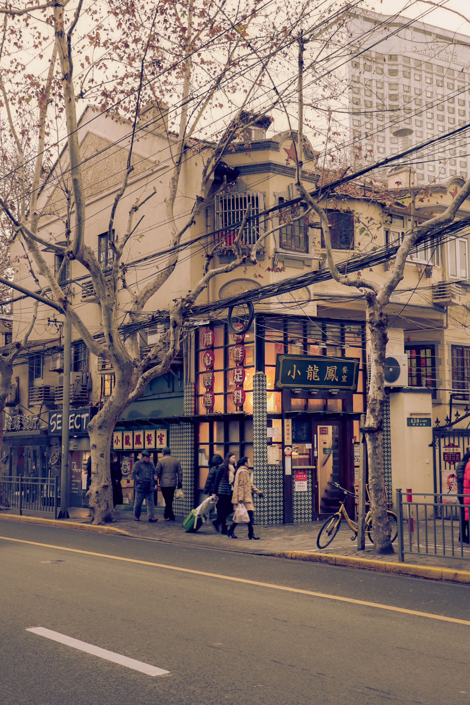 This is a shot of an old restaurant on South Shanxi Road in Shanghai. The area is my favourite in all of Shanghai. I just love to walk in the streets, surrounded by shady sycamores. There are a lot of great cafes, bars, and restaurants in the neighbourhood. I can literally spend a whole day there without getting bored.  Mingfang Zhang