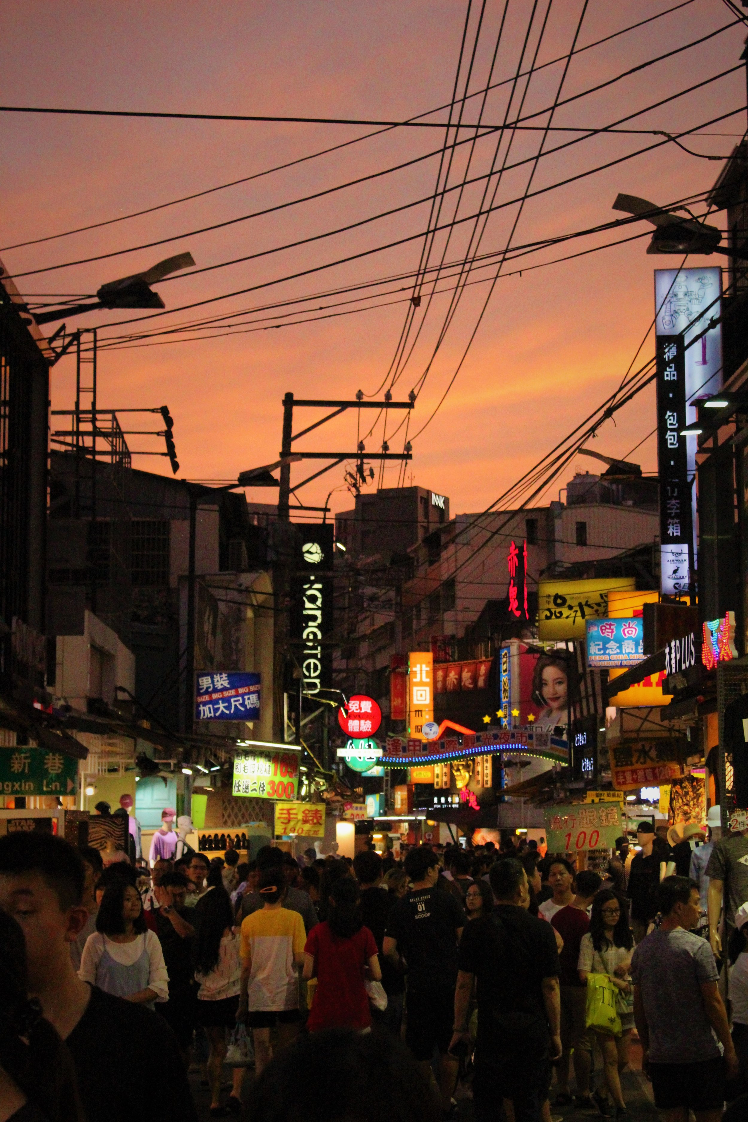 Taichung's Fengjia night market - one of Taiwan's biggest night markets, and a synaesthetic assault everyone should experience at least once.  The list of things to buy and games to play could go on forever, but as a taster, over five hours, food sampled included fried sweet potato balls, stinky tofu, perfectly seasoned grilled mushroom, cheesy potato, taro, douhua - a sweet tofu substance, and finally a bowl of refreshing shaved ice to round off a humid night under Taiwan's setting sun.   Viola King Forbes