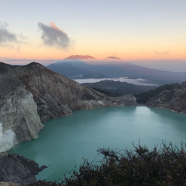 After spending the night camping at the base of this sulfur volcano, Ijen, in Indonesia, we were woken at 1 am to start our hike up. It was pitch black and, in order not to loose each other, our group of 13 had to walk in single file with just headtorches for guidance. Hours later we arrived at the top in time to watch the sunrise over the iconic blue lake!  Harriet Wall