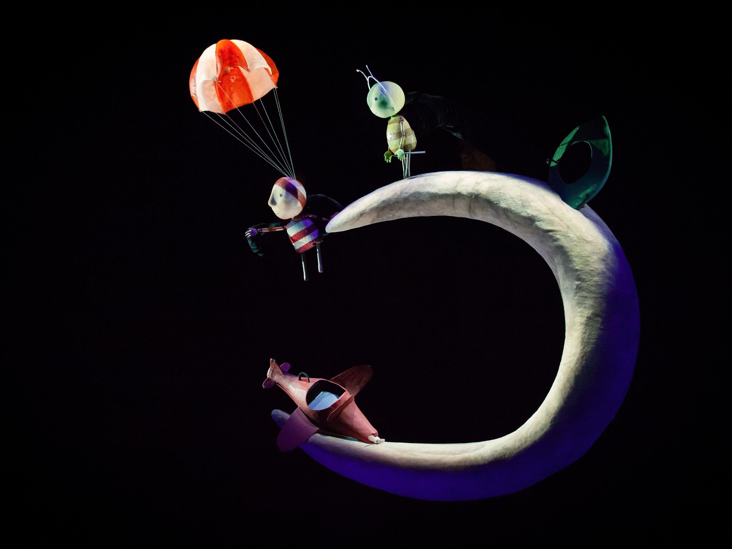 A non-verbal Story about friendship and bravery.   Co-produced with Teater Refleksion , Denmark.  When a boy discovers a single-propeller airplane in his closet, he does what any young adventurer would do: He flies into outer space! This wonderful story explores the boundless imagination of children. Through puppet animation and magical music, we tell the story of one boy's adventure into outer space and the quest he must undertake to help his new friend.  For audiences aged 3 +