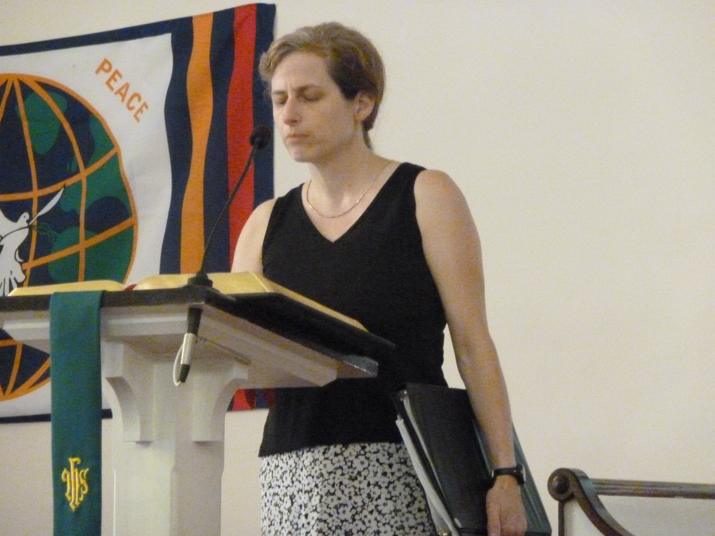 Sue doing a laity reading during worship.JPG