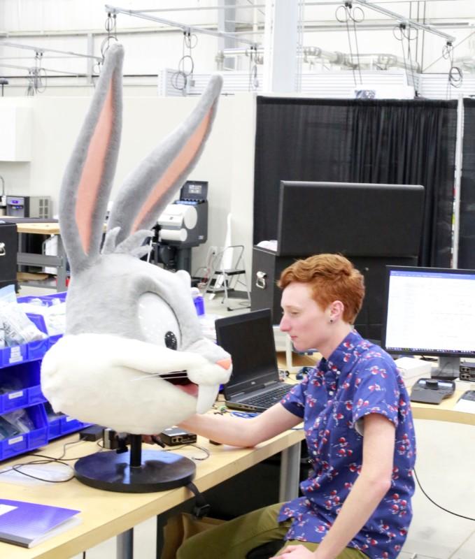 An Animax technician programs a talking character head