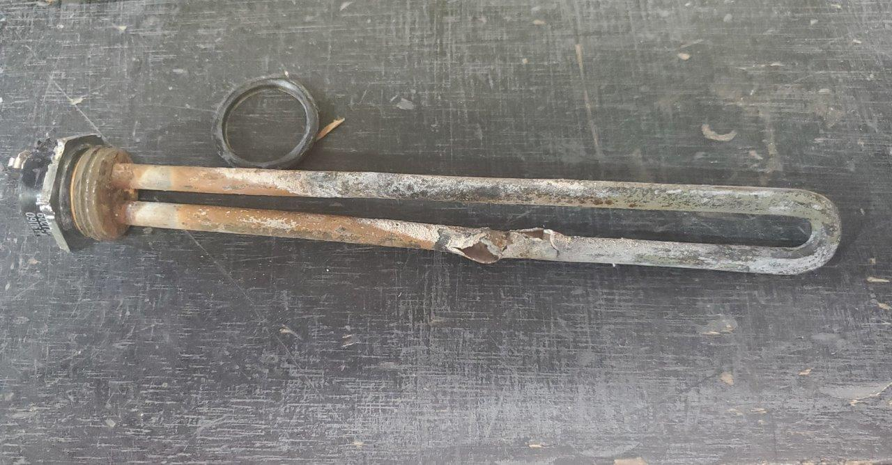 This electric RV water heater element was left on with no water in the tank, causing it to overheat and fail.