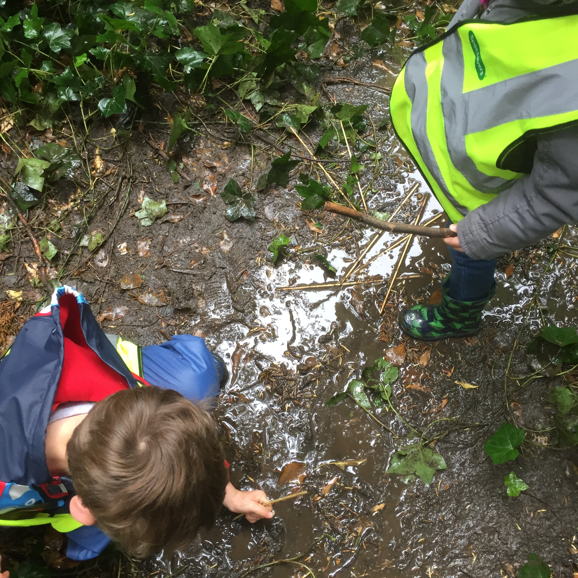 The children loved the muddy stream provided by much needed recent rain.