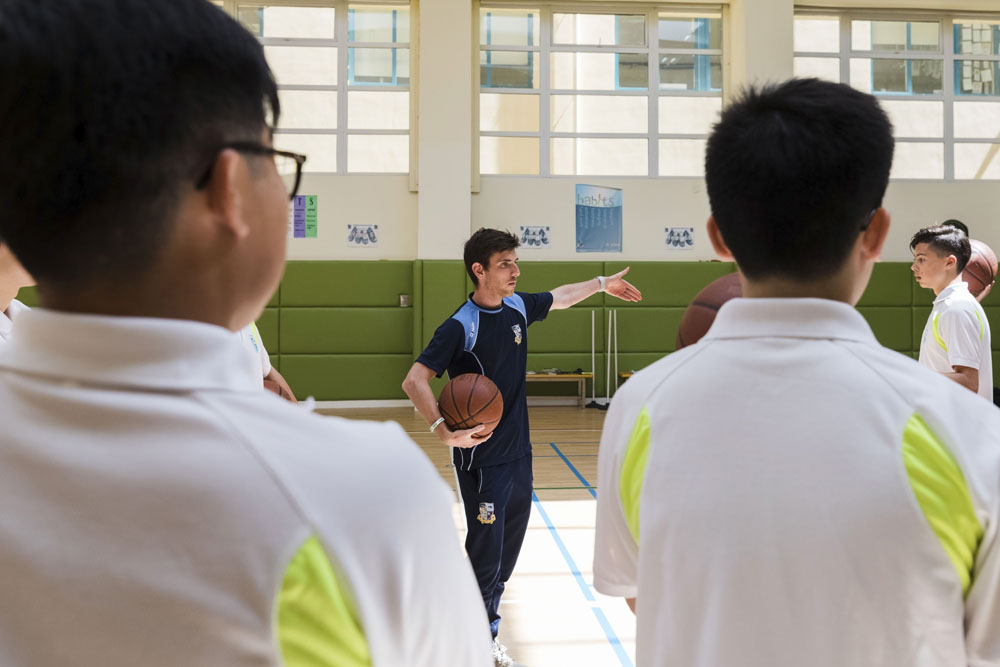 Coaching basketball at Britannica Shanghai.