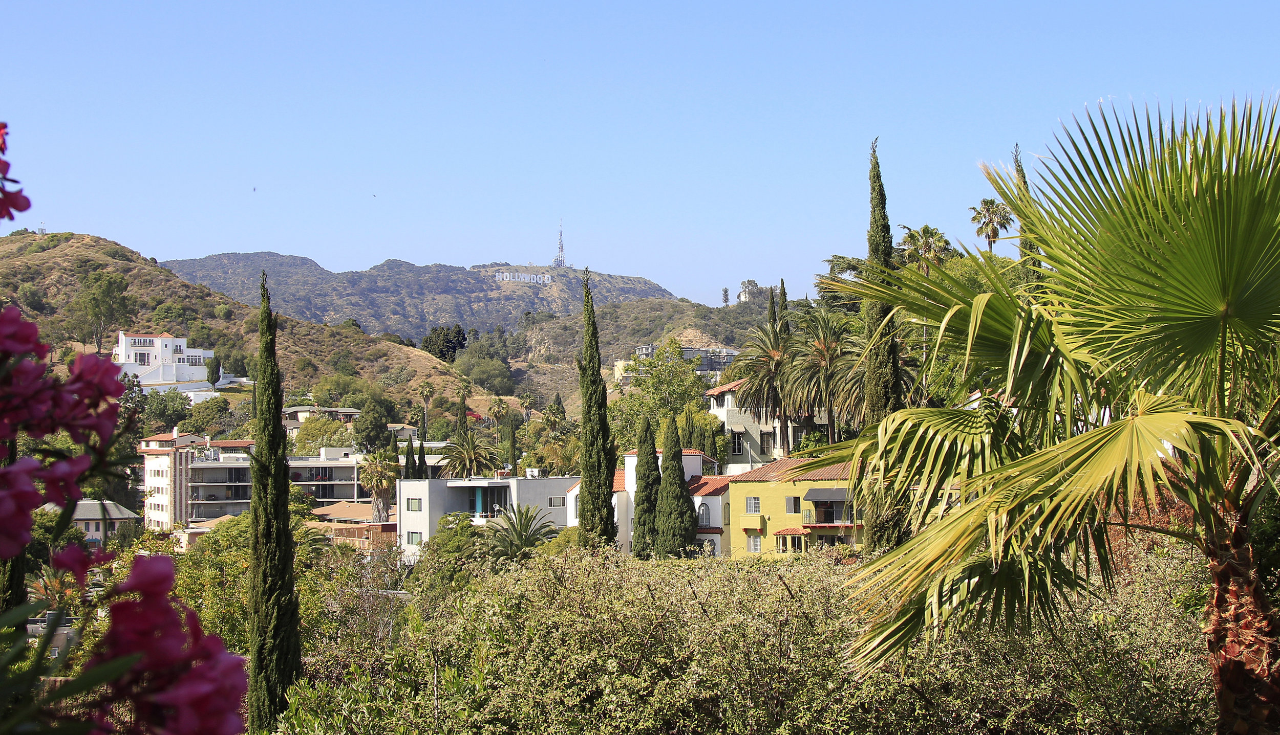 Historic Whitley Heights, a small enclave in the Hollywood Hills, was specifically designed to resemble a Mediterranean style village. In the distance is the famous Hollywood sign atop Mt. Lee.   Learn more about the Whitley Heights and other neighborhoods in the Hollywood Hills East...