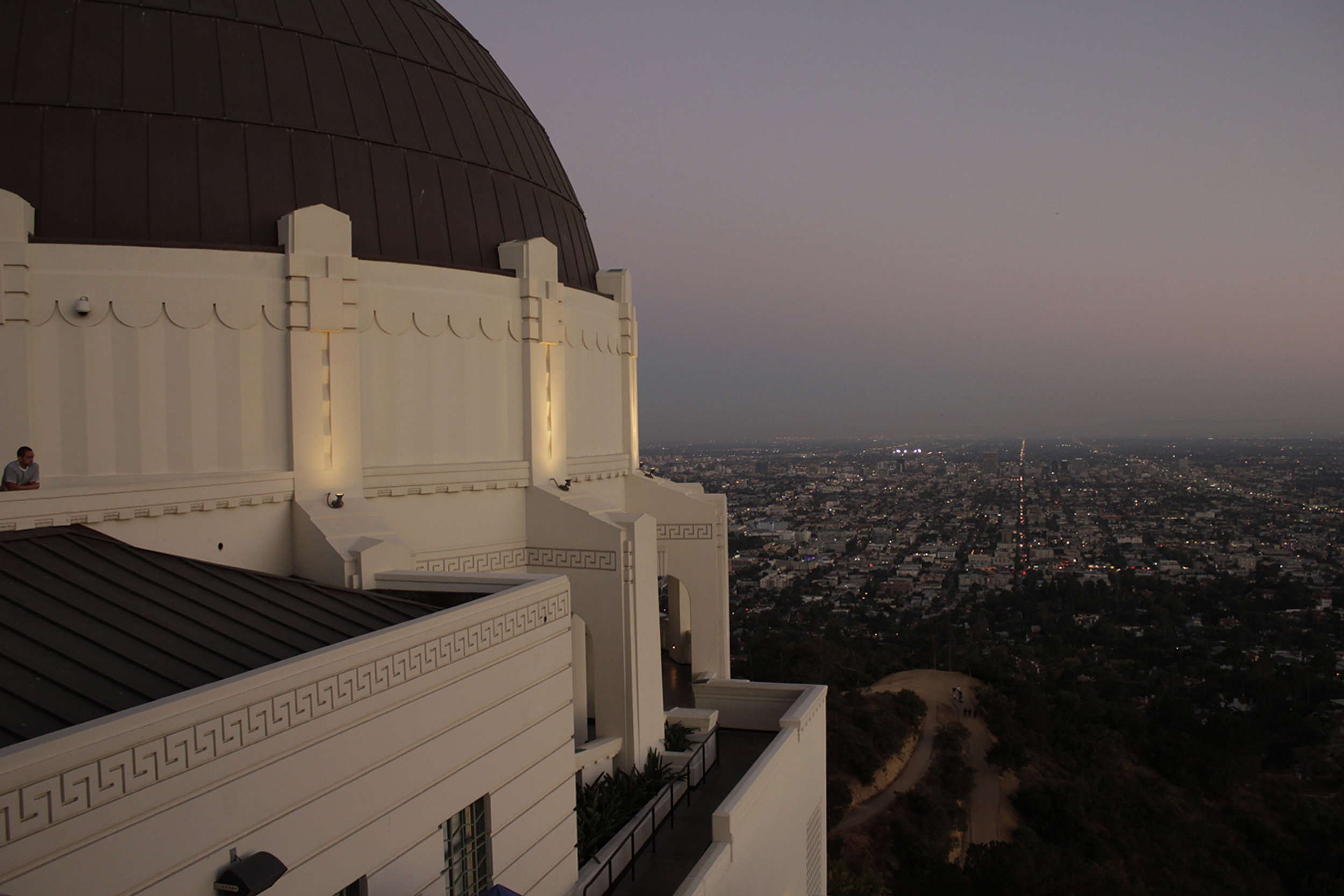 One of Los Angeles' most iconic buildings, the Griffith Observatory, and a view of the city at dusk.