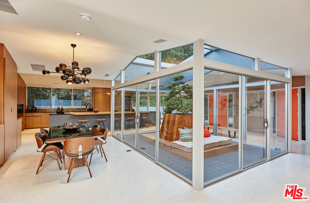 Terrazzo lines the floors of the living room, dining room and kitchen, which all wrap around the home's centerpiece atrium.