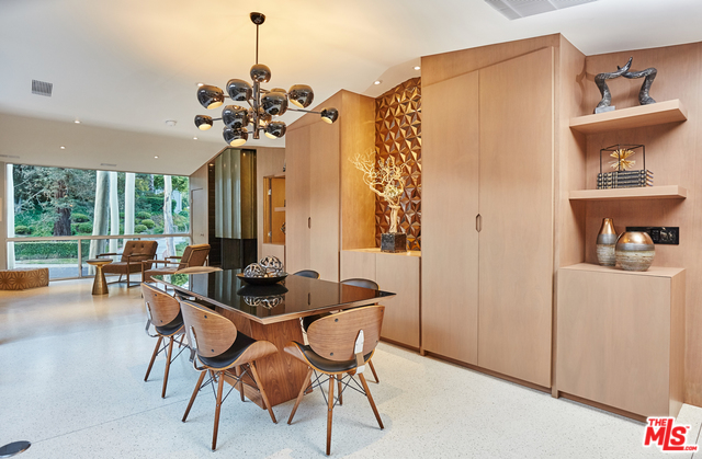 The dining room features beautiful cabinetry extending from the floor all the way up to the vaulted ceiling. And I love the chandelier. Be sure to include that in your offer!