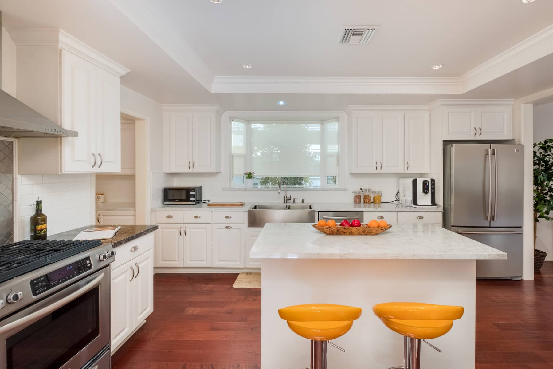 I said 21st century amenities, didn't I? Check out the kitchen. Spacious, bright, new, stainless steel, center island. It has it all.