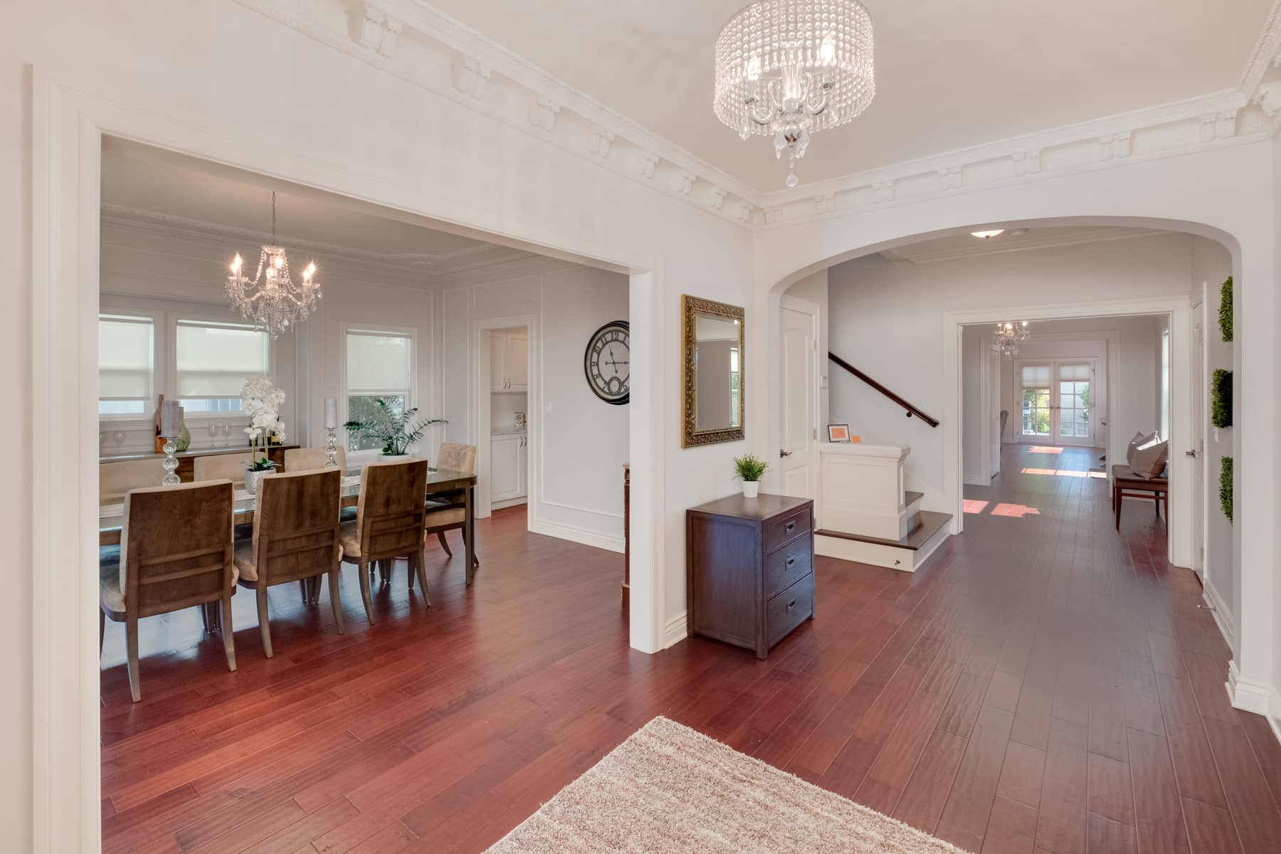 The elegance of this 1918 Traditional is perfectly complemented by 21st century amenities. The first thing you notice as you step through the double front doors and into the spacious foyer is the ornate cornice work overhead. And as you peer into the dining room to your left you'll notice a continuation of this, but with a different pattern. It's always a pleasant thing to find a home where this sort of detail has been maintained, even after it has undergone a complete renovation, as is the case with this house.