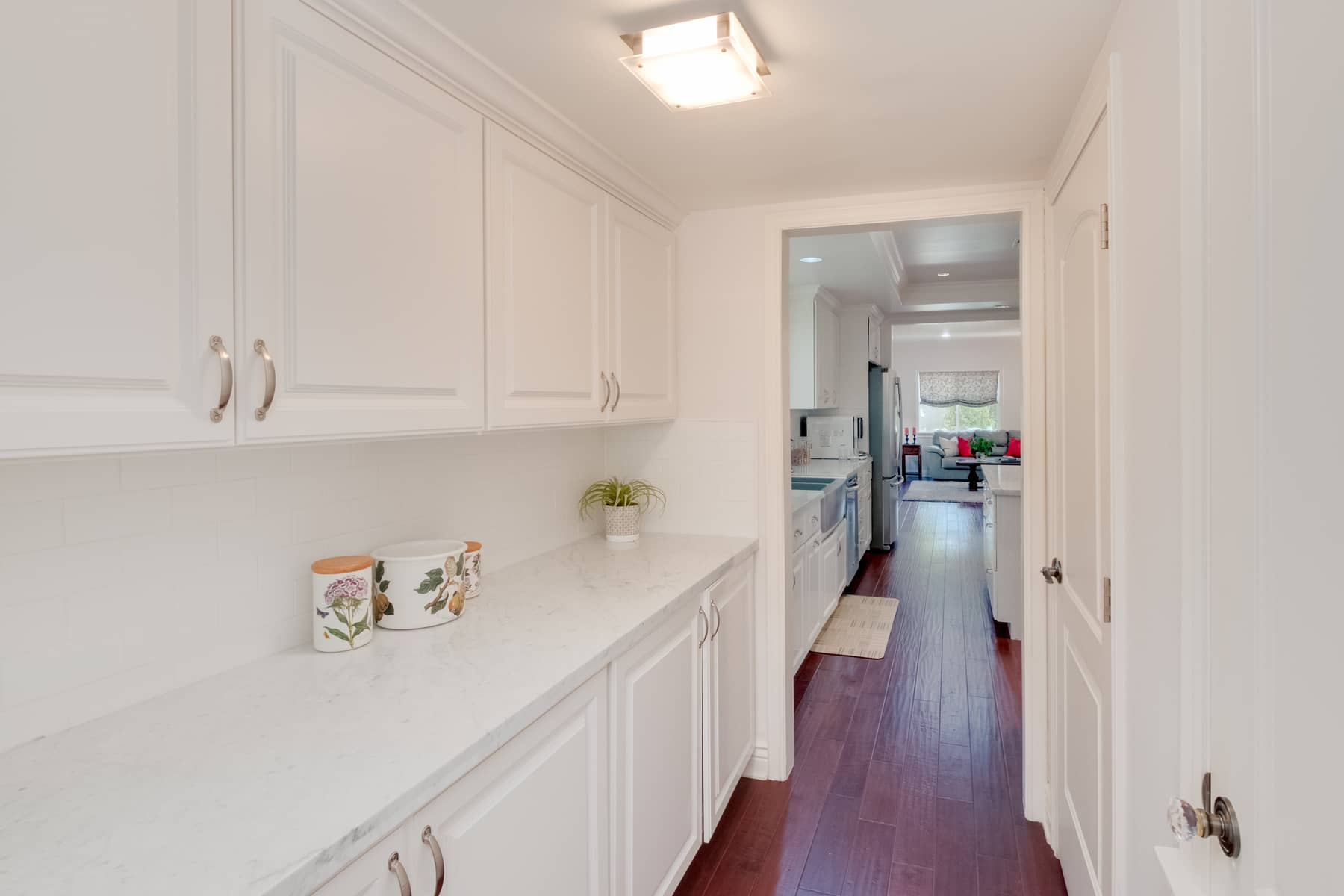 Form a function are evident everywhere, such as this beautiful pantry hallway that connects the kitchen to the dining room.
