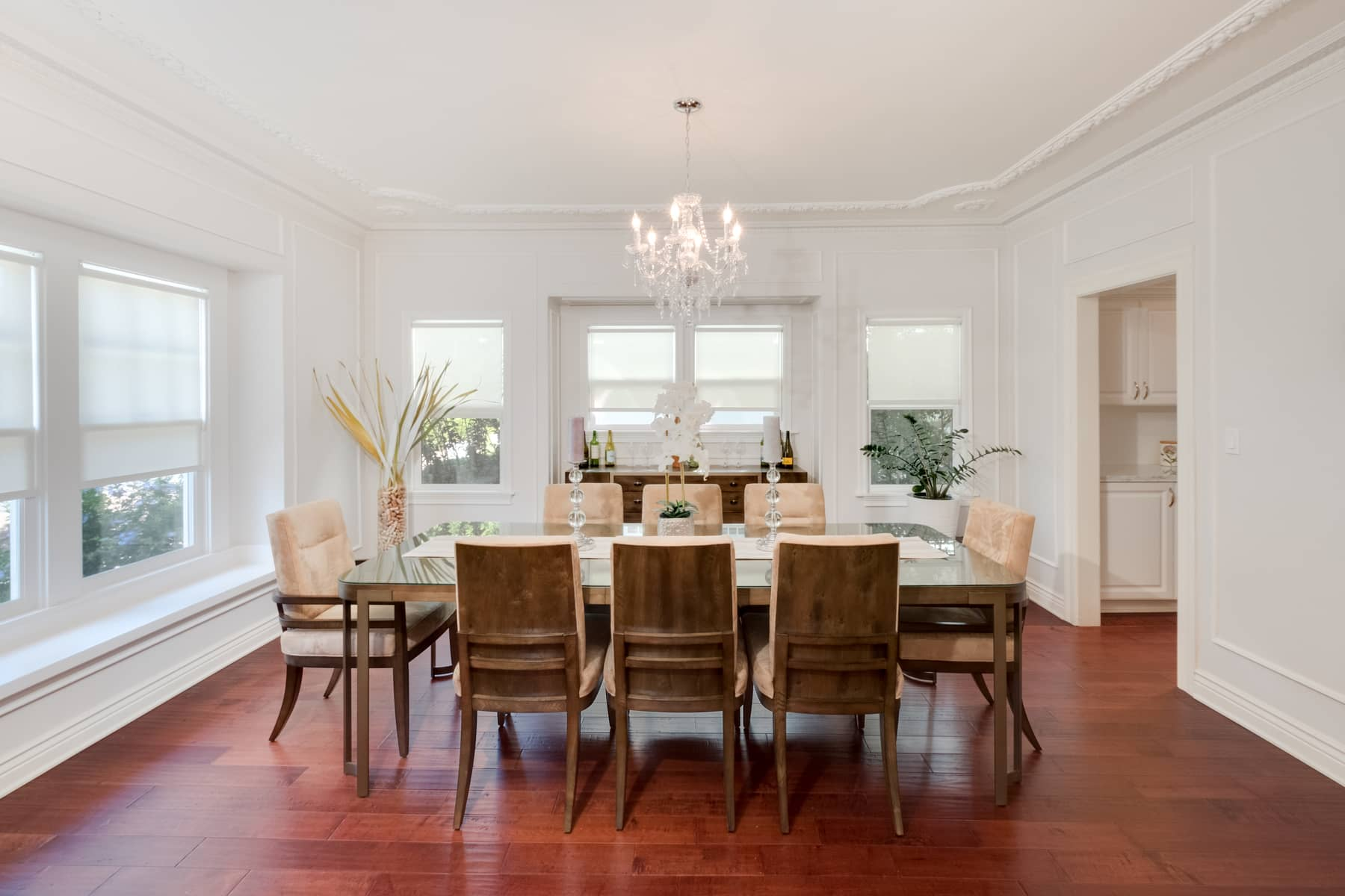 The dining room easily seats 8. And that's not counting the cozy built-in seating area along the front picture window!