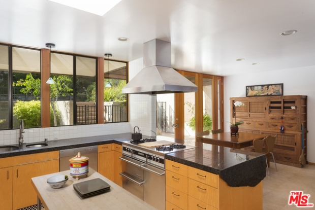 As with the living room and dining room, the kitchen boasts volume and light. Break out the chef's knife, Tamar, because this is a great workspace!