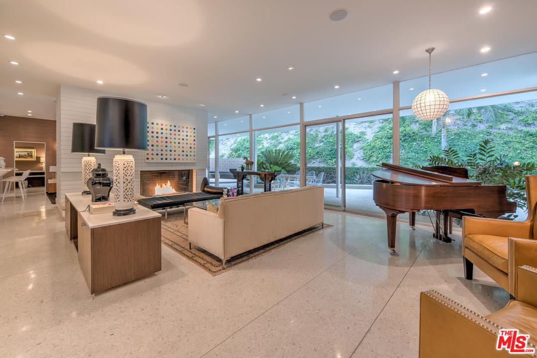 Inside, classic elements abound. The living room and family room are masterfully divided by an oversized, dual-sided fireplace, which stands in the center of the adjoined spaces.
