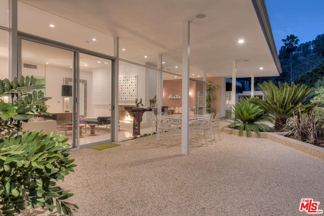 A covered patio is an essential element for outside dining and lounging during the hot days of summer.