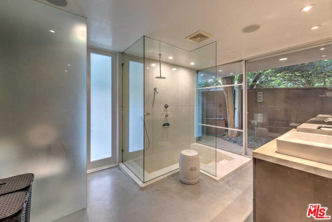 A very cool step-down tub and shower in the master suite.