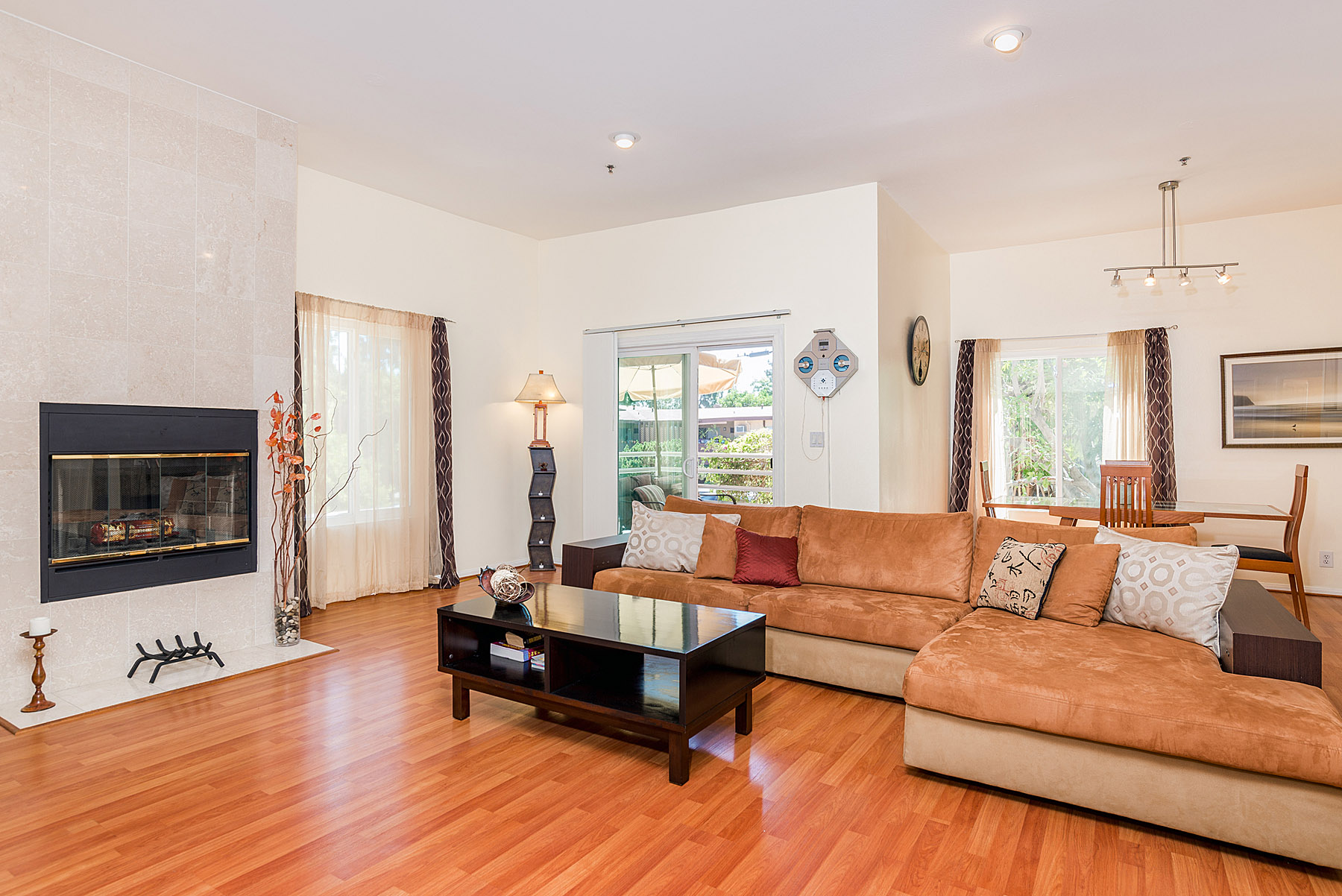 Open and spacious living area, with cozy fireplace.