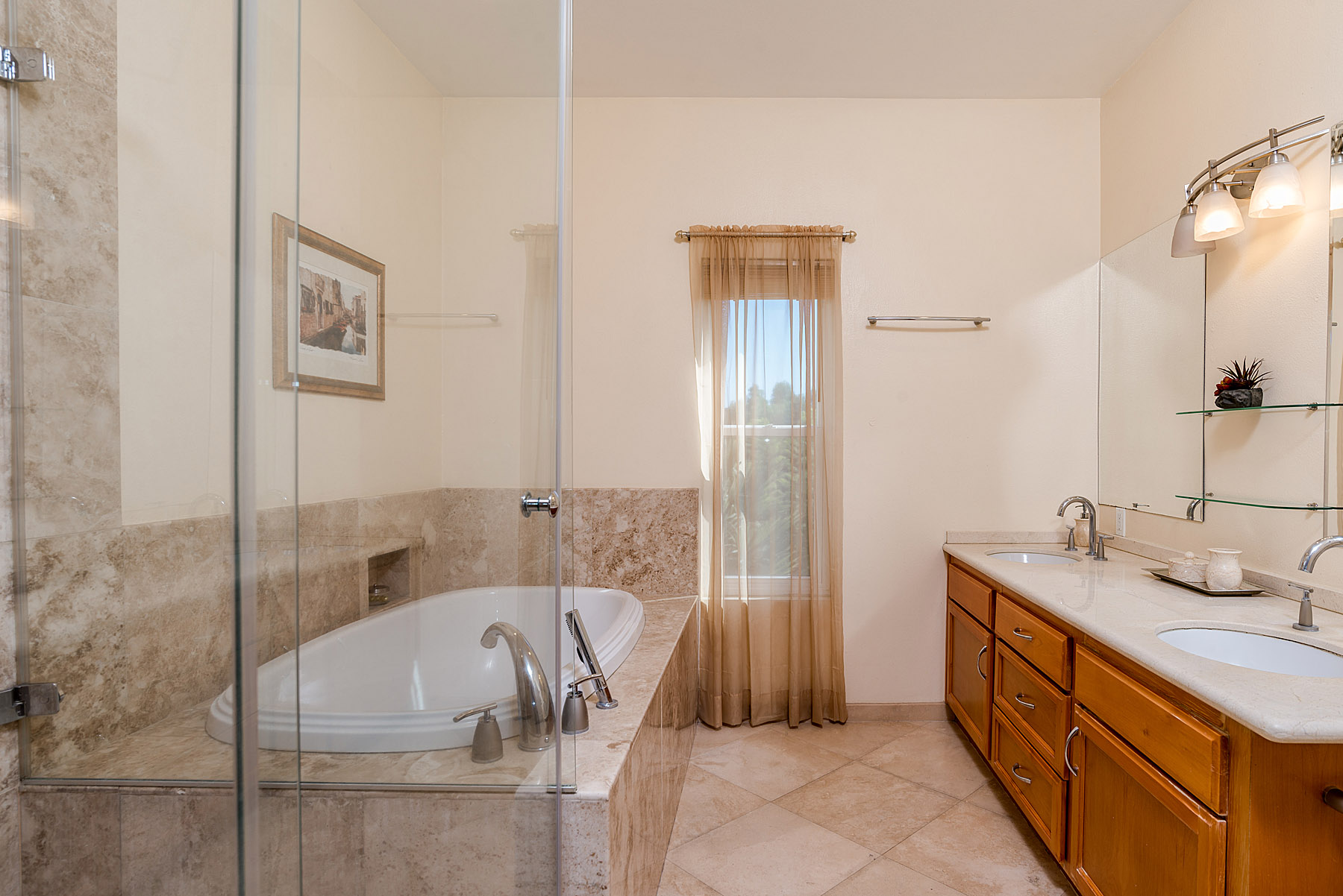 The master bedroom's en suite bath also features a tub and marble imported from Italy.