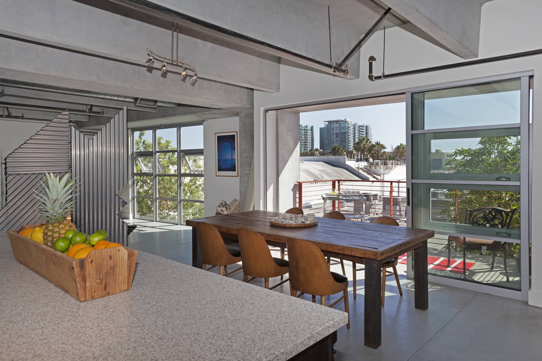 Space and light. That's what this home's interior is all about. And thanks to the location of this west-facing end-unit, you'll enjoy the beautiful glow of magic hour filling your home every day as the sun recedes over the horizon, just beyond your balcony.